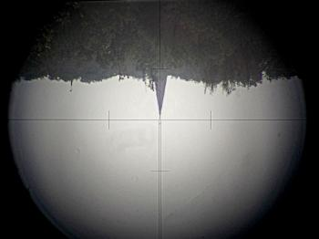 The view of the Wild T1 is inverted with a reticle similar to the Carl Zeiss Th1.