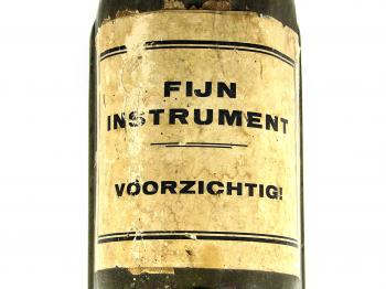 "The label of the container reads ""Fine instrument, be careful!""."
