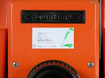 The Geodimeter is labelled with a sticker of its former owner.