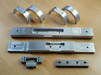 The freshly machined parts for the GTT60 mounting, ready for anodising.