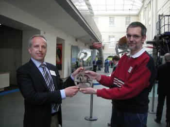 G�nther Oestmann (right) handing over the astrolabe copy to me at the NMM in Greenwich.
