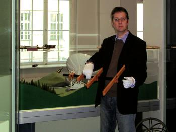 Curator Klaus Staubermann showing the just received cross-staff replica.